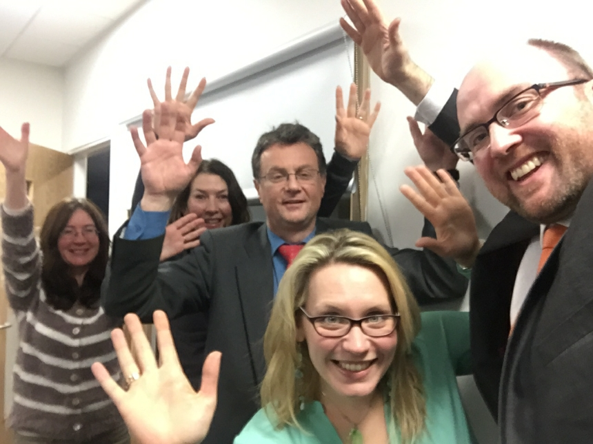 Left to right: Angela, Susan, Bill, Nikki and Dan raising hands for rare diseases at the February meeting of the Haemophilia Scotland Board of Trustees.